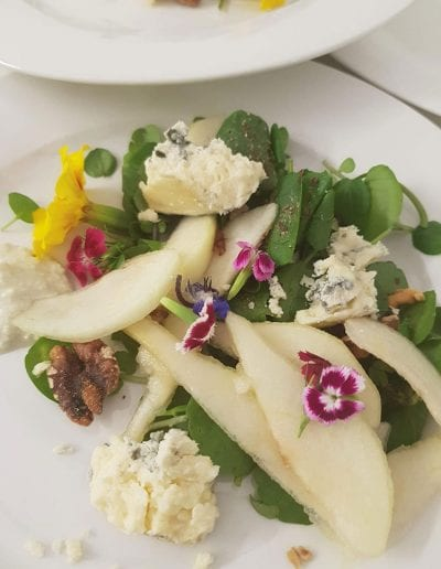 Pear and watercress salad with edible flowers